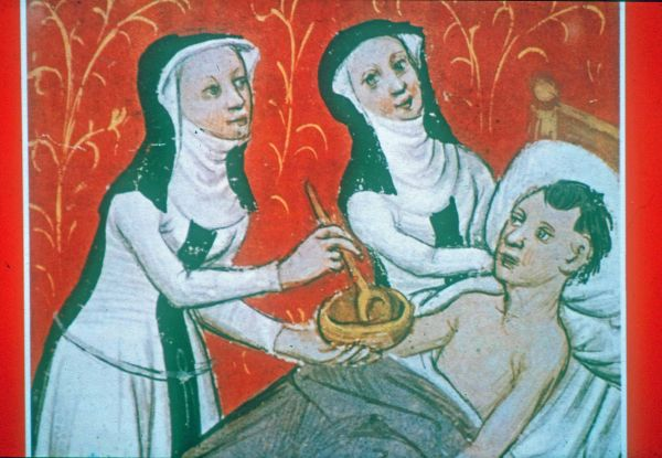 Depiction of nurses feeding a patient, Archives of the Hospital of Notre Dame, Tournai, foundation charter of 1238